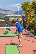 Boy loves to play Mini-Golf Stock Photos