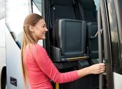 Happy passenger boarding on travel bus Stock Photos