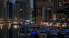 View of Dubai Marina Towers and canal in Dubai night to day timelapse Stock Footage
