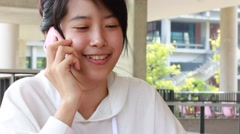 Portrait of thai student university beautiful girl calling smart phone Stock Footage