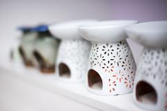 Elegant ceramic ware for candle in yoga room in modern gym Stock Photos