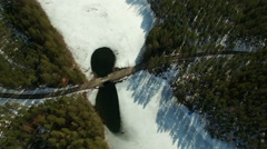 High aerial shot of a country road with melt ice around a bridge at a springtime Stock Footage