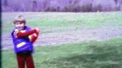 1968: Cute young boy swings wiffle baseball bat runs imaginary bases. Stock Footage
