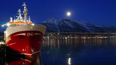 The ship stands near the shore.  Moon over the city at night Stock Footage