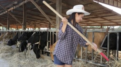 Cowgirls working dairy farms. - stock footage