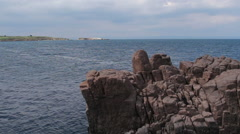 Sea rocks of Sozopol and view to St. Ivan island Stock Footage
