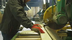 Lumber mill worker is cutting wood with circular saw Stock Footage