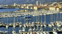 Boats entering sailboat marina Toulon France Stock Footage