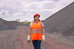 The woman in protective working clothes. labor protection Stock Photos