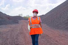 Work in the dusty place. Open mines. The working person at factory - stock photo
