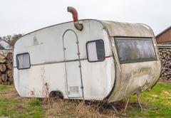 rundown old caravan - stock photo