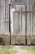 rundown old barn door - stock photo