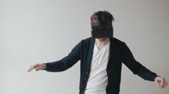 Man Using The Virtual Reality Headset, Doing Movements, Skateboard Imitation Stock Footage