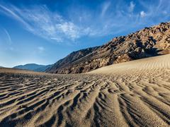 Sand dunes in mountains - stock photo