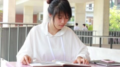 Portrait of thai student university beautiful girl read a book Stock Footage