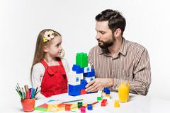 Father and daughter playing educational games together Kuvituskuvat