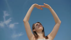 The young girl hides the face in hands what the sun wouldn't arrest attention - stock footage