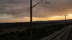 Moving train at sunset point of view Stock Footage