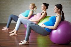 Exercising on balls - stock photo