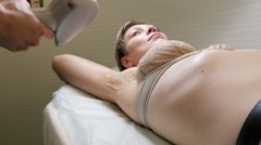 Woman gets laser hair removal treatment underarm Stock Footage