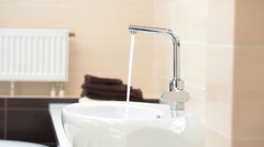 Sink in bathroom. Faucet at home Stock Footage