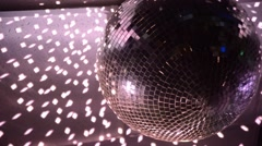 Spinning discoball, over black background Stock Footage