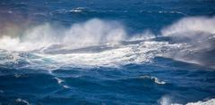 Ripples texture of stormy sea. - stock photo