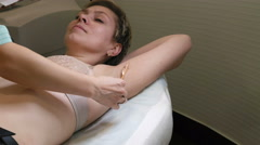 Appling obtusion gel before laser hair removal Stock Footage