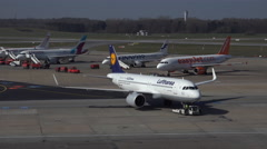 4k Lufthansa Airbus A320-200 leading to runway Hamburg airport airfield Stock Footage