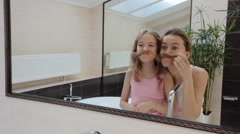 Mother combing daughter hair - stock footage