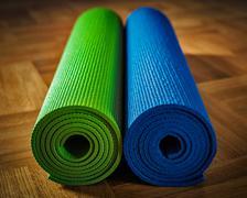 Yoga mat on floor - stock photo