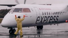 Bombardier Q400 - 74 passenger prop plane - on tarmac fueling up - stock footage