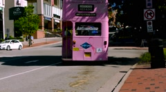 Pink bus - double decker British bus - AEC Routemaster - stock footage