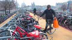 Amsterdam, Bicycle Parking Lot. Holland. Cycling, people, crowded Stock Footage