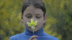 Portrait of a boy in the spring with a flower of yellow narcissus. - stock footage
