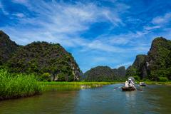 Tourists on boats in Vietnam - stock photo