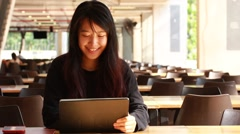 Portrait of thai student university beautiful girl using her tablet Stock Footage
