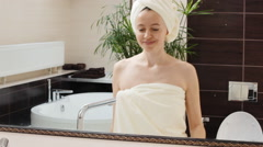 Happy singing woman washes in the morning at bathroom Stock Footage