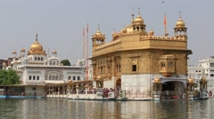 Indian people visiting the Golden Temple in Amritsar, Punjab, India Stock Footage