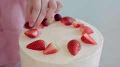 Beautiful young woman cooking cake at kitchen Stock Footage
