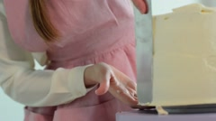 Woman is making cakes in the kitchen Stock Footage