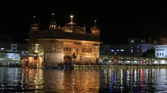 Indian people visiting the Golden Temple in Amritsar at night. India Stock Footage