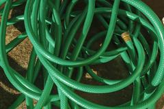 Tangled Green Hose Pipe - stock photo