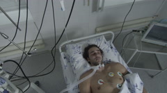 The man in intensive care unit at the hospital Stock Footage