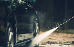 Detailed Car Washing Using Pressured Water Spraying. - stock photo