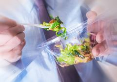 Healthy Office Food Eating Concept Photo. Office Worker Eating Diet Food. - stock photo
