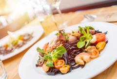Italian Food Serving. Black Pasta with Sea Food. Italian Food. Stock Photos