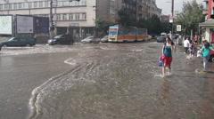 Girl crossing flooded boulevard Stock Footage