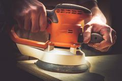 Restoring Wood Sections of Furniture by Sanding. Sanding Process Closeup - stock photo