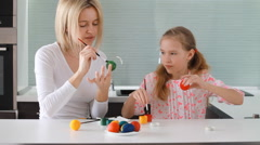 Easter. Mother and child painting eggs Stock Footage